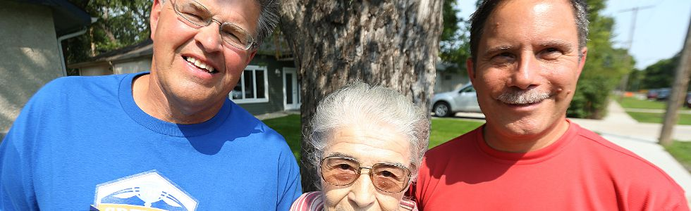 Author Daniel Perron (right) has written a book called Dancing Gabe: One Step at a Time about Winnipeg sports personality Gabe Langlois (left). They're pictured outside the Langlois home in St. Vital with his mother Angelina on Fri., Aug. 28, 2015. Kevin