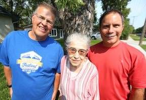 Author Daniel Perron (right) has written a book called Dancing Gabe: One Step at a Time about Winnipeg sports personality Gabe Langlois (left). They're pictured outside the Langlois home in St. Vital with his mother Angelina on Fri., Aug. 28, 2015.