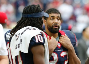 The fantasy stock of a couple of Houston Texans doesn't look too promising at the moment: Running back Arian Foster (right) because of his groin injury, and wide receiver DeAndre Hopkins (left) because of the team's sorry QB situation. (USA TODAY SPORTS)