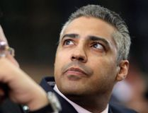FILE -- Canadian Al-Jazeera English journalist Mohamed Fahmy, right, listens to his lawyer, Khaled Abou Bakr during his retrial in a courtroom, of Tora prison, in Cairo, Egypt, Monday, June 1, 2015. An Egyptian court has sentenced Fahmy and two other Al-Jazeera English journalists to three years in prison, the last twist in a long-running trial criticized worldwide by press freedom and human rights activists. (THE CANADIAN PRESS/AP, Amr Nabil)