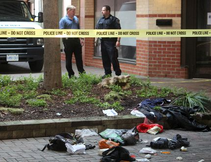 Police are investigating a downtown London assault that critically injured a man. Investigators remained on the scene at a courtyard near Dufferin Avenue and Richmond Street Saturday morning. DALE CARRUTHERS / THE LONDON FREE PRESS