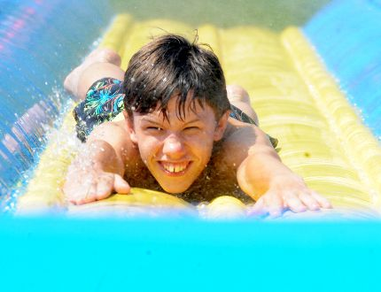Sheldon Martell, 12, of Brockville, enjoys the waterslide at Beachfest, at St. Lawrence Park on Sunday. (RONALD ZAJAC/The Recorder and Times)