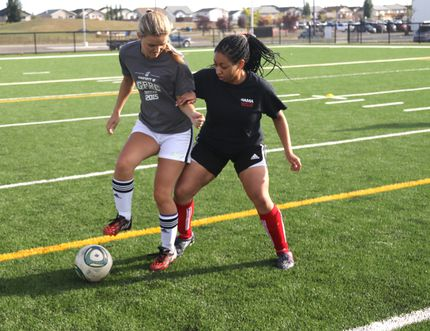Regan Clarke, left, tries to protect the soccer ball from Fiona Kato, right, during the Grande Prairie Regional College Wolves women's soccer tryouts on Thursday Aug. 27, at the Community Knowledge Campus field in Grande Prairie. Logan Clow/Grande Prairie Daily Herald-Tribune/Postmedia Network