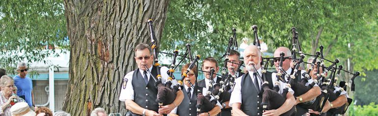 Members of the Stratford Police Pipes and Drums march smartly toward the MusicBarge for a performance on the final day of Stratford Summer Music on Sunday.