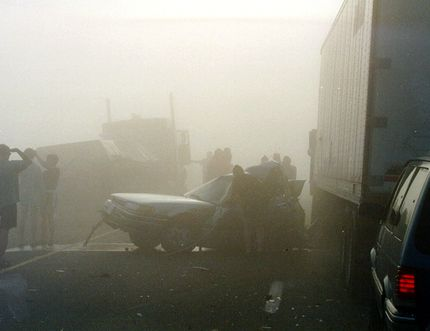 People are barely visible in this photograph taken at a massive pile-up during a foggy morning drive on Highway 401 in Essex County on Sept. 3, 1999. West Regjon OPP are asking drivers to be especially vigilant when faced with fog as they launch a Dense Fog Requires Bright Drivers campaign.