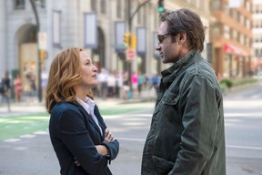 Gillian Anderson as Dana Scully and David Duchovny as Fox Mulder. The next mind-bending chapter of THE X-FILES debuts with a special two-night event beginning Sunday, Jan. 24. (Ed Araquel/FOX)