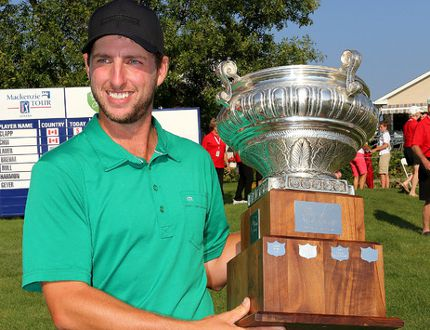 Brad Clapp of Chiliwack, B.C., holds the championship trophy after the final round of the Mackenzie Tour PGA Tour Canada Great Waterway Classic at the Loyalist Golf and Country Club in Bath on Sunday. (Ian MacAlpine/The Whig-Standard)