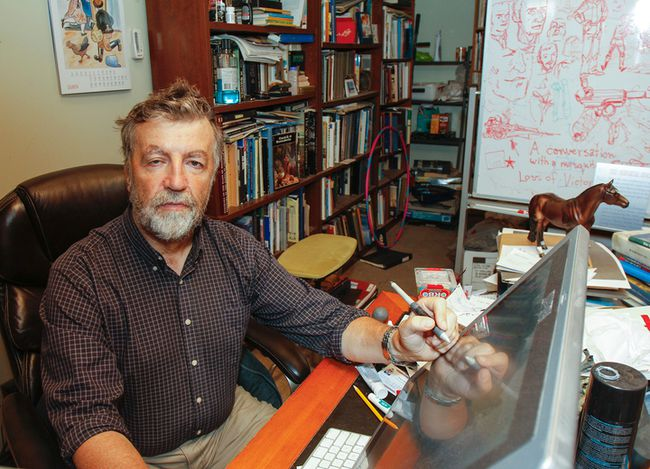 Animation production artist Peter Bielicki surrounds himself with a variety of props, reference books and sketches at his desk in the Woolen Mill building. (Julia McKay/The Whig-Standard)