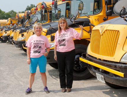 School bus drivers Penny Hughson, left, and Kim Clark are looking forward to the start of school next week. (Julia McKay/The Whig-Standard)