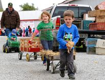 Five-year-old Schyler Sloan leads a parade of Sloan family members, including his six-year-old sister, Daphne, four-year-old brother, Chandler, and his dad John, away from the Poultry and Rabbit Pavilion at the Spencerville Fair last year. The 160th version of the fair begins September 10. (RECORDER AND TIMES FILE PHOTO)