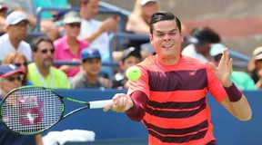 Milos Raonic of Canada returns a shot to Fernando Verdasco of Spain on day three of the 2015 U.S. Open tennis tournament at USTA Billie Jean King National Tennis Center. Anthony Gruppuso-USA TODAY Sports