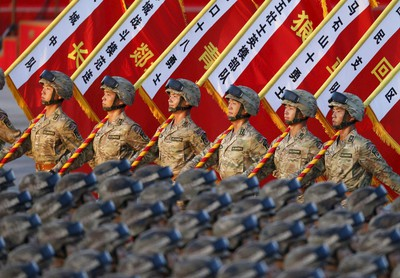 Soldiers of the People's Liberation Army (PLA) of China stand in formation as they gather ahead of a military parade to mark the 70th anniversary of the end of World War Two, in Beijing, China, September 3, 2015. REUTERS/cnsphoto C