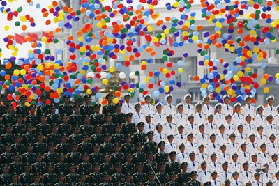 Colourful balloons are released at the end of the military parade marking the 70th anniversary of the end of World War Two, in Beijing, China, September 3, 2015. REUTERS/Damir Sagolj