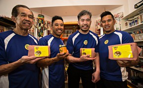 (From left) Chee Liaw and his sons, Alex, Albert and Allen, pose for a photo at Liaw's home in Edmonton, Alta. on Monday, Aug. 31, 2015. The family are the proprietors of Golomein, a company that makes and sells noodles and sauces at the Strathcona Farmer's Market. Albert had a stroke a few years ago and has worked hard to regain his mobility. Albert is now the CFO and VP of marketing in the family business. Codie McLachlan/Edmonton Sun