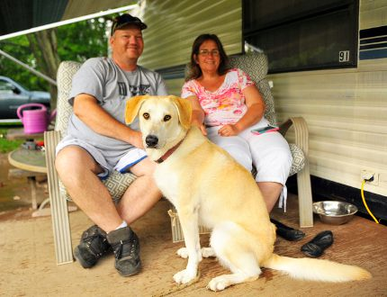 Brantford's Brad Shaw and Wendy Gillingwater enjoy some time with their dog Lacey at Waterford North Conservation Area Thursday. Local campgrounds have seen a spike in numbers this year. Not surprisingly, there are few spots available for the upcoming Labour Day weekend. (JACOB ROBINSON Simcoe Reformer)