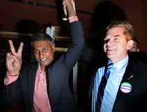 Prasad Panda celebrates with Brian Jean.