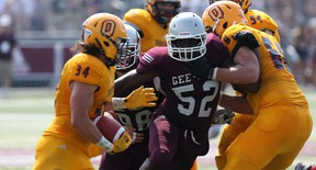 University of Ottawa Gee-Gees defensive lineman Henry Quan tries to make a play on the Queen's Golden Gaels ball carrier Jesse Andrews as the teams opened the season at Gee-Gees Field on Sunday, Sept. 6, 2015. (Chris Hofley/Ottawa Sun)