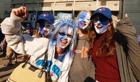 Jack Boland/Postmedia Network Toronto Blue Jays fans celebrate before a game in this file photo. More than half of Star readers who responded to a poll think the Jays will win the World Series this year.