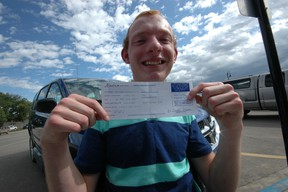 Aaron Friesen of Ranfurly poses with his just-received driver's license in August. Friesen, who has cerebral palsy, set out to drive to school on his first day of Grade 12 at Delnorte School in Innisfree and accomplished that goal last week.