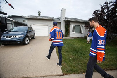 Edmonton Oilers Cam Talbot (right) and Nail Yakupov drop off season tickets at long time ticket holder Bob Kindrachuk's home in Edmonton, Alta., on Wednesday September 9, 2015. Kindrachuk and his friends have atttended Oilers games since the team's start in Edmonton in the late 1970's. Ian Kucerak/Edmonton Sun/Postmedia Network