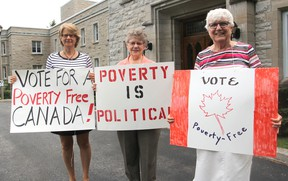 Bridget Doherty, left, Sister Shirley Morris and Sister Pauline Lally stand in front of the motherhouse of the Sisters of Providence of St. Vincent de Paul in Kingston, Ont. on Thursday, Sept. 10, 2015 holding signs for the Friday vigil that will end after 20 years. Michael Lea/The Whig-Standard/Postmedia Network