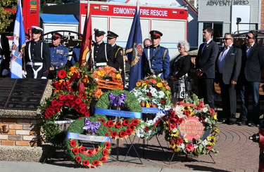 Wreaths sit ready to be laid at the foot of the Firefighters Memorial Plaza at 10318-83 Ave., during the Edmonton Firefighters Memorial Society, Remembrance Service on Friday Sept. 11, 2015. The annual event is to recognize all Edmonton firefighters who made the ultimate sacrifice by giving their lives in the line of duty since 1922. Tom Braid/Edmonton Sun/Postmedia Network.