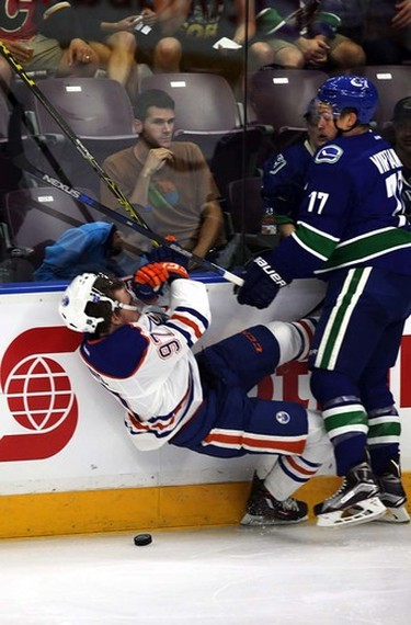 Edmonton Oilers' Connor McDavid gets hit by Vancouver Canucks Jake Virtanen (77) during the Young Star game at Penticton, BC on September11 2015. Perry Mah/Edmonton Sun/Postmedia Network