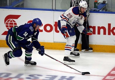 Edmonton Oilers' Leon Draisaitl gets his stick check out of hands by Vancouver Canucks' Brendan Gaunce during 3rd period in Young Stars game at  Penticton, BC on September11 2015. Perry Mah/Edmonton Sun/Postmedia Network