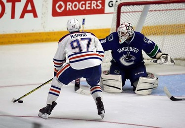 Edmonton Oilers' Connor McDavid takes a shot on Vancouver Canucks' Clay Witt during the Young Stars game at  Penticton, BC on September11 2015. Perry Mah/Edmonton Sun/Postmedia Network