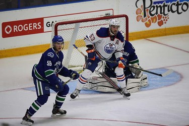 Edmonton Oilers' Mitch Moroz is guarded by Vancouver Canucks' Ashton Sautner during the Young Stars game at  Penticton, BC on September11 2015. Perry Mah/Edmonton Sun/Postmedia Network