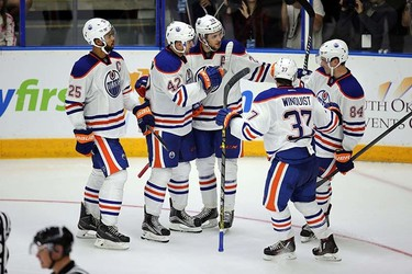 Edmonton Oilers'  Leon Draisaitl (29) celebrates his goal on the Vancouver Canucks with eammates Darnell Nurse (25), Anton Slepyshev (42), Joey Laleggia (84), and Josh Winquist (37)  during 3rd period in Young Star game at  Penticton, BC on September11 2015. Perry Mah/Edmonton Sun/Postmedia Network