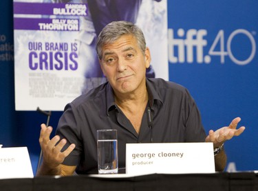 "Producer George Clooney attends a news conference to promote the film ""Our Brand is Crisis"" at the Toronto International Film Festival (TIFF) in Toronto, September 12, 2015.  REUTERS/Fred Thornhill"
