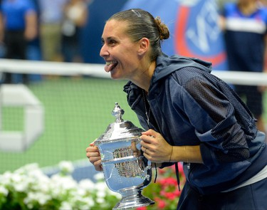 Sep 12, 2015; New York, NY, USA; Flavia Pennetta of Italy celebrates with the trophy after beating Roberta Vinci of Italy in the women's singles final on day thirteen of the 2015 U.S. Open tennis tournament at USTA Billie Jean King National Tennis Center. Robert Deutsch/USA TODAY Sports