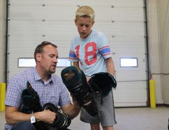 Greg, left, and Gavin Clark, 13 look at equipment during Grande Prairie Minor Hockey Association's annual used equipment sale on in September 2015 at the Coca-Cola Centre. Logan Clow/Daily Herald-Tribune