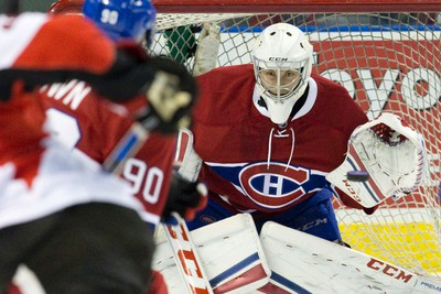 Montreal Canadiens goaltender Zachary Fucale watches as a puck shot by Ottawa Senators forward Matt Puempel closes in during their NHL Rookie Tournament hockey game at Budweiser Gardens in London, Ont. on Sunday September 13, 2015. Craig Glover/The London Free Press/Postmedia Network