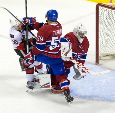 Ottawa Senators forward Vincent Dunn (36) gets tied up with Montreal Canadiens defenceman Dalton Thrower (59) and Canadiens goaltender Zachary Fucale during their NHL Rookie Tournament hockey game at Budweiser Gardens in London, Ont. on Sunday September 13, 2015. Craig Glover/The London Free Press/Postmedia Network