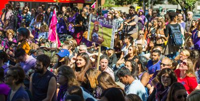 People gather at the corner of Spadina Ave and Bloor St W during the CUPE 3902 Women's Caucus Demonstration Against Gendered Violence in Toronto, Ont.  on Monday September 14, 2015. Ernest Doroszuk/Toronto Sun/Postmedia Network