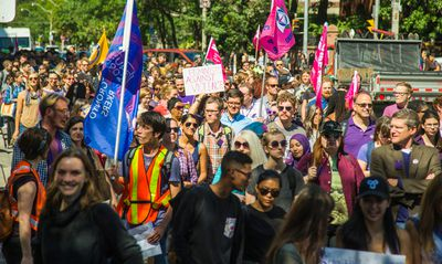 People make their way along St. George St during the CUPE 3902 Women's Caucus Demonstration Against Gendered Violence in Toronto, Ont.  on Monday September 14, 2015. Ernest Doroszuk/Toronto Sun/Postmedia Network