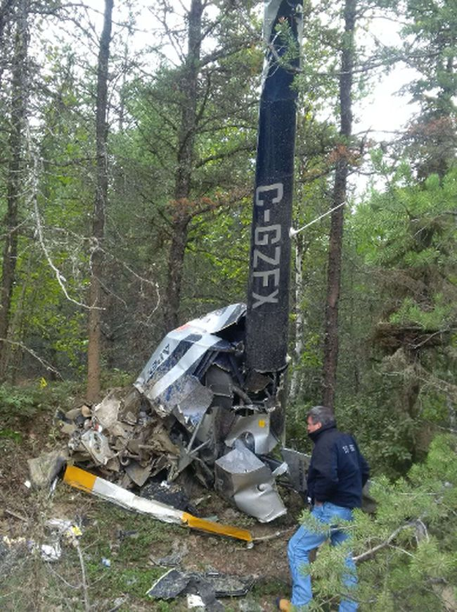 A photo provided by the Transportation Safety Board of Canada shows TSB inspectors at the wreckage site of a helicopter crash in the Foleyet that was the focus of an extensive search last week