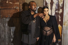 Kanye West stands with his wife Kim Kardashian after watching the Givenchy Spring/Summer 2016 collection during New York Fashion Week in New York September 11, 2015.  REUTERS/Lucas Jackson