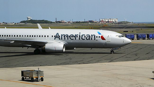 """Officials say a Chicago-bound American Airlines flight was diverted to Indianapolis after a woman struck another passenger and a flight attendant. Jeff Dutton, the airport's communications manager, says the woman had to be detained during the flight and was taken to the back of the plane. Dutton says the pilot decided to divert the flight after the woman struck a flight attendant and a passenger. According to Dutton, the woman also kicked an airport police officer as she was being escorted off the plane. <a href=""""http://www.canoe.com/Travel/News/2015/09/15/22551918.html"""" target=""""_blank"""">Read the full story here.</a> (REUTERS/Brian Snyder)"""