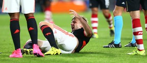 Manchester United's Luke Shaw grimaces after being injured during the Champions League Group B match between PSV and Manchester United at Philips Stadium in Eindhoven, Netherlands, on Tuesday, Sept. 15, 2015. (Peter Dejong/AP Photoa)