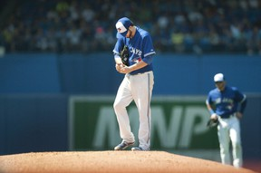 Toronto Blue Jays starting pitcher Drew Hutchison pauses on the mound before throwing against the New York Yankees at Rogers Centre in Toronto on August 16, 2015. (THE CANADIAN PRESS/Fred Thornhill)