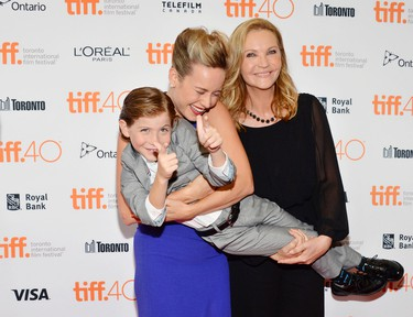 """Brie Larson, and Joan Allen, right, hold Jacob Tremblay at the premiere for """"Room"""" on day 6 of the Toronto International Film Festival at the Princess Of Wales Theatre on Tuesday, Sept. 15, 2015, in Toronto. (Photo by Evan Agostini/Invision/AP)"""