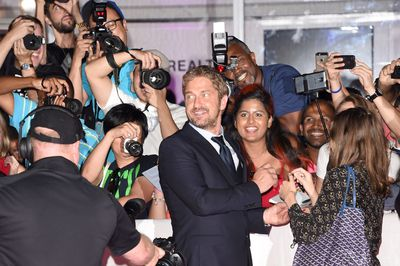 """TORONTO, ON - SEPTEMBER 15: Producer Gerard Butler attends the """"Septembers of Shiraz"""" premiere during the 2015 Toronto International Film Festival at Roy Thomson Hall on September 15, 2015 in Toronto, Canada.   Jason Merritt/Getty Images/AFP"""