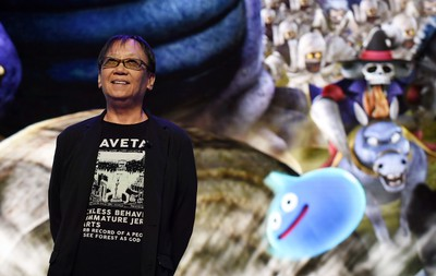 """Japanese game designer Yuji Horii introduces his new """"DragonQuest"""" series titles during the Sony Computer Entertainment Japan Aisa (SCEJA) press conference in Tokyo on Sept. 15, 2015. SCEJA held the event prior to the Tokyo Game Show starting on Sept. 17. (AFP PHOTO/TOSHIFUMI KITAMURA)"""