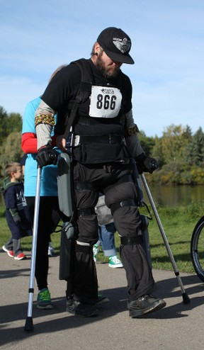 Denny Ross, who was paralyzed from the chest down in a car accident five years ago, attempts to finish a 5 Kilometre race at the annual N.E.R.D. Run at William Hawrelak Park in Edmonton, Ab., on Saturday, Sept. 19, 2015, with the use of a ReWalk Exoskeleton. CLAIRE THEOBALD Edmonton Sun