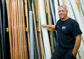 Marty Salliss of Salliss Plumbing and Heating says business spiked after a late June storm hammered London with rain. (MIKE HENSEN, The London Free Press)