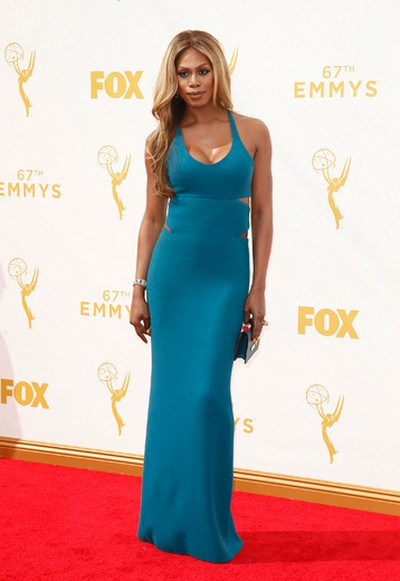 "Star: Laverne CoxGrade: B+This long blue Calvin Klein Collection gown wins for the details. The cut-out sides and the criss-cross back, matched with yellow stilettos is incredible! (Danny Moloshok/Invision for the Television Academy/AP Images)  PDRTJS_settings_8239510 = { ""id"" : ""8239510"", ""unique_id"" : ""default"", ""title"" : """", ""permalink"" : """" }; (function(d,c,j){if(!document.getElementById(j)){var pd=d.createElement(c),s;pd.id=j;pd.src=('https:'==document.location.protocol)?'https://polldaddy.com/js/rating/rating.js':'http://i0.poll.fm/js/rating/rating.js';s=document.getElementsByTagName(c)[0];s.parentNode.insertBefore(pd,s);}}(document,'script','pd-rating-js'));"