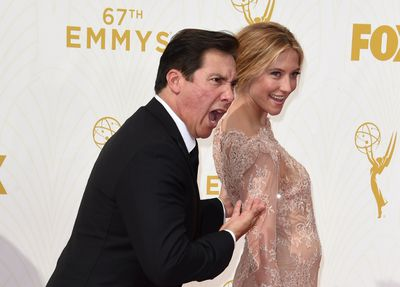 Caitlin Gerard  (R) attends the 67th Emmy Awards, September 20, 2015 at the Microsoft Theatre in downtown Los Angeles. AFP PHOTO / MARK RALSTON
